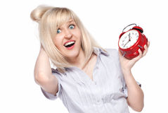 Shocked beautiful young woman with alarm clock Stock Images