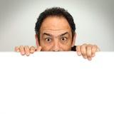 Shocked behind billboard stock photo