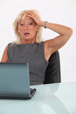 Shocked blond businesswoman Royalty Free Stock Images