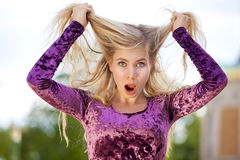 Shocked blond fashion model Stock Image