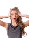 Shocked blonde female looking at you isolated Royalty Free Stock Images