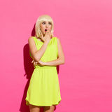 Shocked blonde girl on the pink wall Stock Photo