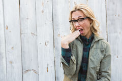 Shocked blonde in glasses gesturing Stock Photo