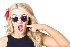 Shocked blonde makeup woman. Cosmetic application Stock Image