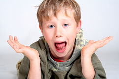 Shocked Boy. Close up of a young boy's scared/shocked expression royalty free stock photo