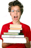 Shocked boy with set of books Stock Photo