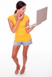 Shocked brunette woman with a laptop Stock Photography