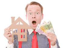 Shocked business houseowner with money Royalty Free Stock Images