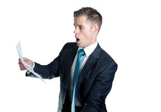 Shocked business man. Business man shocked by high bill Stock Images