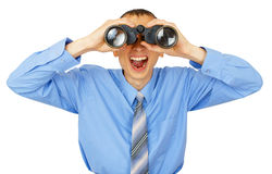 Shocked business man with blue tie with binoculars. Isolated on white background Stock Images