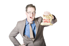 Shocked business man holding sale cash back bag Stock Image