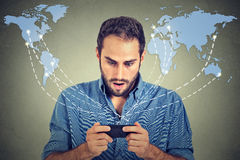 Shocked business man holding using smartphone Royalty Free Stock Images