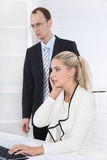 Shocked business people looking depressed on computer received a Stock Photo