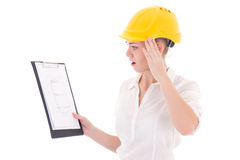 Shocked business woman architect in yellow builder helmet holdin Stock Photos