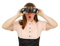Shocked business woman with binoculars Stock Photography