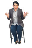 Shocked business woman on chair Royalty Free Stock Photography