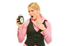 Shocked business woman holding alarm clock Royalty Free Stock Images