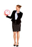 Shocked business woman holding office clock Stock Photos