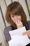 Shocked business woman reading letter Stock Photo