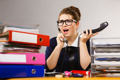 Shocked business woman talking on phone Stock Photography