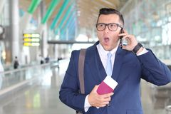 Shocked businessman at the airport Royalty Free Stock Photography