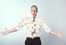 Shocked businessman covered by blank post-it notes. Stock Photo