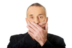 Shocked businessman covering mouth Royalty Free Stock Photography