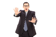 Shocked businessman gesturing rejection Royalty Free Stock Image