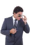 Shocked businessman with glasses holding keys Royalty Free Stock Image