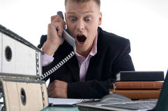 Shocked Businessman Holding Receiver Royalty Free Stock Images