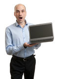 Shocked businessman with Laptop computer stock images