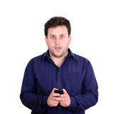 Shocked businessman looking at cell phone against white backgrou Royalty Free Stock Image