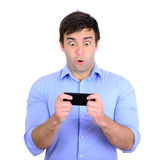 Shocked businessman looking at cell phone Stock Photography