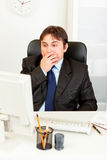 Shocked businessman looking at computer monitor Royalty Free Stock Photo