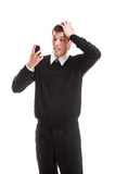 Shocked businessman looking at mobilephone. Isolated on white background Royalty Free Stock Images