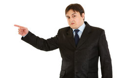 Shocked businessman pointing finger in corner Stock Photo