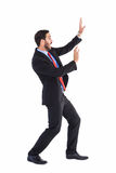 Shocked businessman protecting himself with these hands Royalty Free Stock Photography