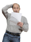 Shocked. Businessman reading bad news letter Royalty Free Stock Photography