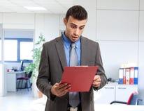 Shocked businessman. Reading a document Stock Photo