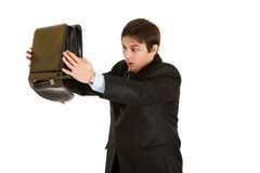 Shocked businessman searching something in case. Shocked modern businessman searching something in briefcase isolated on white royalty free stock photos