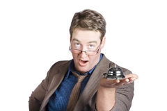 Shocked businessman with service bell. Bad service. Appalled middle aged executive businessman in brown coat holding service bell with frustrated look. Bad Royalty Free Stock Images