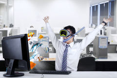 Shocked businessman with snorkeling mask at office Stock Image