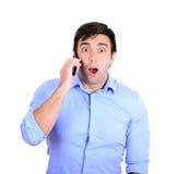 Shocked businessman talking on phone Stock Images