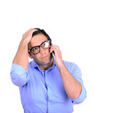 Shocked businessman talking on phone Stock Photography