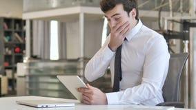 Shocked Businessman Using Tablet in Wonder stock footage
