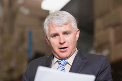 Shocked businessman in warehouse Royalty Free Stock Images