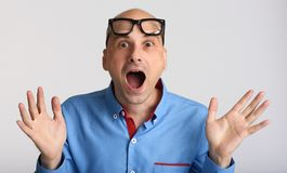 Shocked businessman wearing glasses royalty free stock images