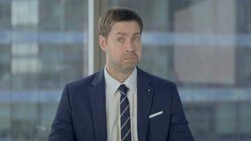 Shocked Businessman Wondering in Awe. The Shocked Businessman Wondering in Awe stock footage
