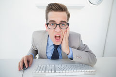 Shocked businessman working on computer Stock Image