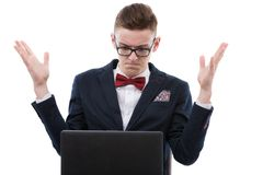 Shocked businessman working on a laptop Stock Photography